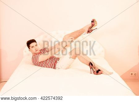 Doll-themed Celebration Of Transgender Girl Party. Attractive Young Man Trying On High-heeled Model