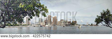 Waikiki - April 21, 2018: Panoramic Of Yachts And Boats Sail In Ala Wai Harbor With Skyline Of Waiki