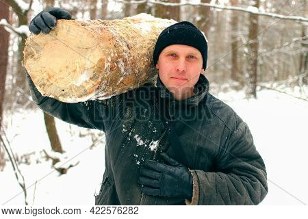 Peasant In Winter With Firewood. Woodcutter In The Winter Forest.