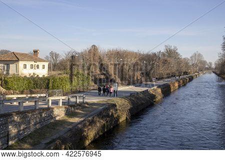 Robecco Sul Naviglio ( Mi ), Italy - April 01, 2021: Robecco Sul Naviglio Town And Naviglio Grande,