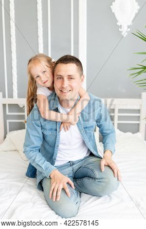 Dad And Daughter Play Have Fun Playing Or Fooling Around At Home On The Bed, Happy Family Or Father'