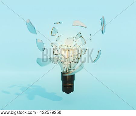 Broken Light Bulb With Pieces Of Glass Around It And Illuminated Filament. Explosive Idea Concept, M