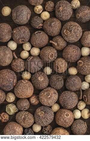 Dry Peas Of Allspice And Hot Peppers Of Different Sizes. Background And Wallpaper, Close-up.