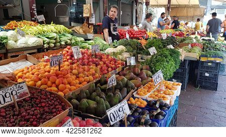 Counter Of Street Market Stall With Various Fruits, Greenery And Vegetables. Authentic Local Market