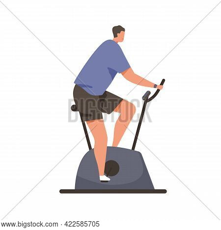 Man Cycling On Stationary Bicycle. Person In Sportswear Training His Endurance On Bike Equipment. Ca