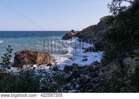 Rough Sea With Waves Crashing Against Cliffs In Crimea, Black Sea