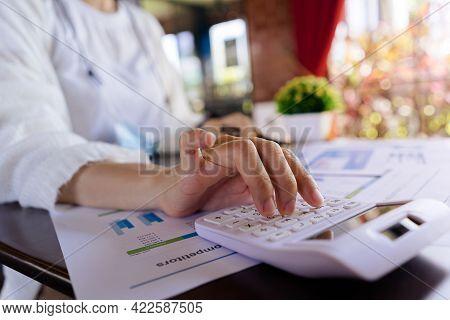 Close Up, Woman Accountant Or Entrepreneur Using Calculator Loan Paper, Income Report, Profit Statis