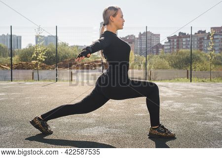 Happy Sportswoman Stretching On The Playground. Smiling Young Blond Woman Fitness In The Morning. Pr