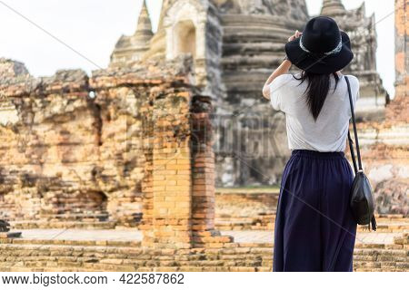 Asian Female Tourists Taking Pictures At Wat Phra Si Sanphet, Phra Nakhon Si Ayutthaya, Thailand.