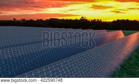 Solar Panel Background Of Photovoltaic Modules For Renewable Energy. Clouds And Blue Sky In Mirror.