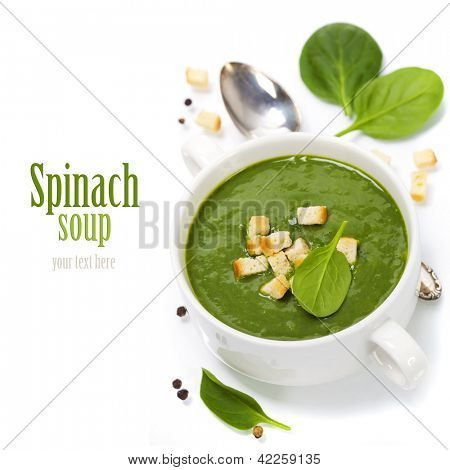Traditional Spinach cream soup with croutons and fresh spinach leaf on top (with easy removable sample text)