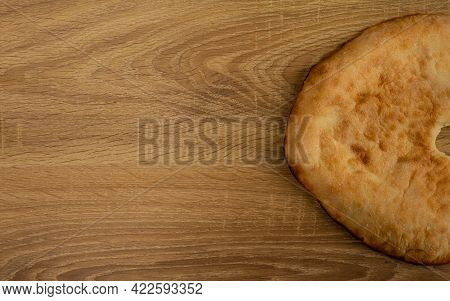 Fried Sun Flapjack On Wooden Background With Copy Space