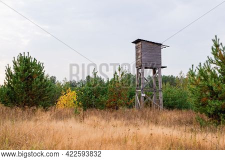 Autumn Landscape With A Hunting Tower. Wooden Observation Tower At The Edge Of The Autumn Forest.