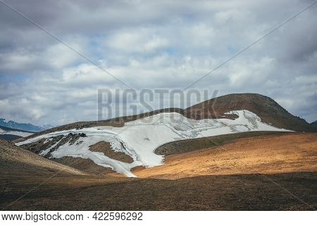 Sunny Mountain Desert Relief With Glacier In Sunlight Under Low Cloudy Sky. Scenic Highlands Landsca