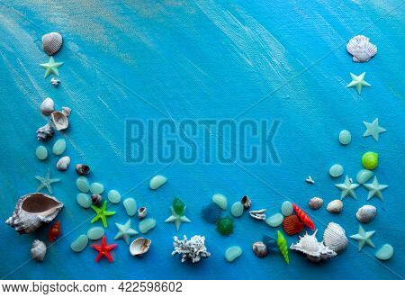 Seashells Summer Background. Many Different Seashells, Starfish On A Background Of Blue Shimmering S