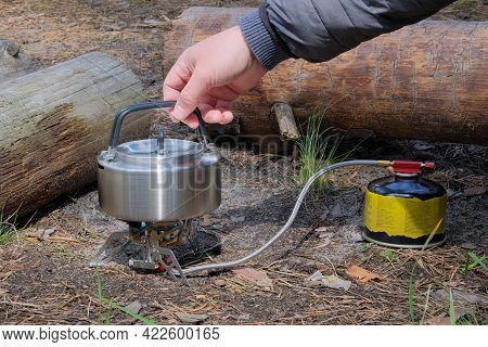 Tourist Food For Outdoor Activities. Metal Teapot On A Forest Background. Enjoy A Tasty Food During
