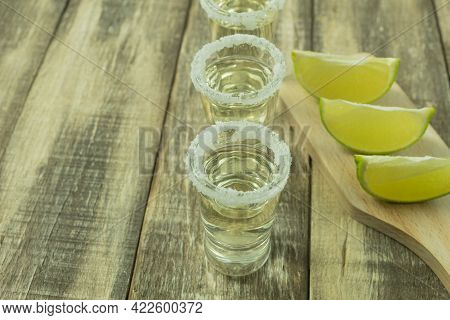 Tequila In A Glass With Salt And Lime. Lime With Salt And Tequila Close-up Photo, Side View. Backgro