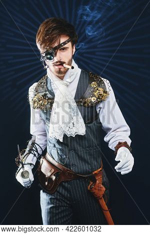 Portrait of a handsome noble man with steampunk gadgets on a black background with starlight. Steampunk concept.