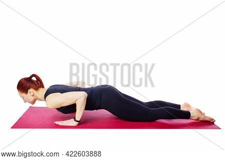 Healthy Lifestyle And Sports. A Slender Athletic Girl Does Push-ups From Her Knees On A Gym Mat.exer