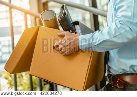 Close Up Businessman Is Carrying A Brown Cardboard Box To Resignation