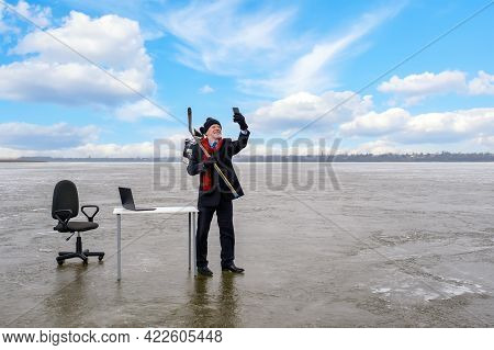 Elderly Businessman In Suit Holds Hockey Stick And Skates, Talking On Sell Phone, Works With Laptop