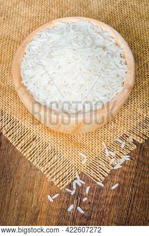 Organic Thai Jasmine Rice Grain In Wooden Bowl Preparing For Cooked