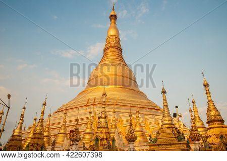 Beautiful View Of Shwedagon Pagoda Is Yangon's Most Famous Landmark In Myanmar At Sunset. Shwedagon