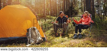 Forest Camping - Young Hiker Couple Enjoying Cup Of Tee At Campsite