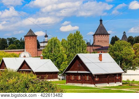 View Of Monastery Of Saint Euthymius And Wooden Houses In Suzdal, Russia. Suzdal Cityscape