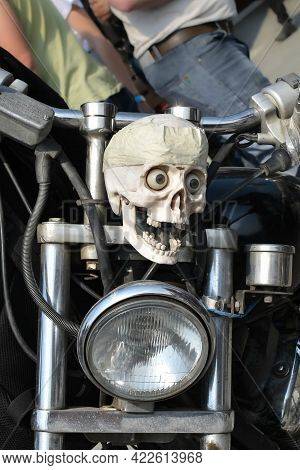 Retro Motorcycle Is Decorated With Scary Skulls. Skull With Eyes On Handlebars Of Bicycle. Poor Yori