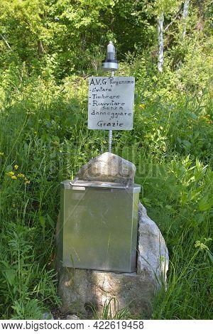 A Box Containing The Summit Register On Monte Purgessimo In Udine Province, Friuli-venezia Giulia, N