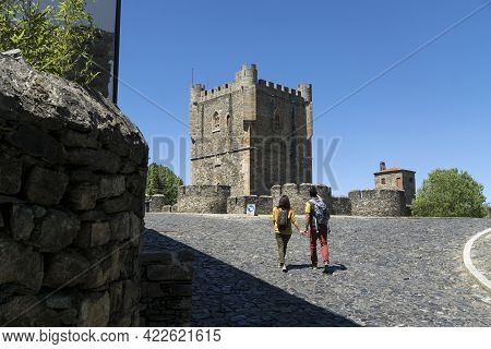 Braganza, Portugal - May 04, 2019: Couple Walking Down The Streets Of The Old Town Of Bragança And T