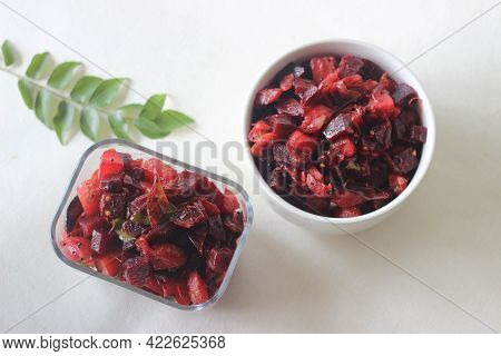 Stir Fried Beetroot And Potato Cubes With Shallots, Dry Red Chillies And Curry Leaves. A Side Dish F