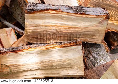 Chopped Firewood In A Heap, Close-up, Prepared For The Winter To Heat The House. Fuel For Stove And