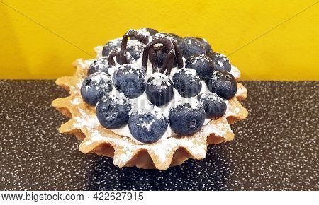 Fresh Large Blueberries With Powdered Sugar In A Shortbread Basket