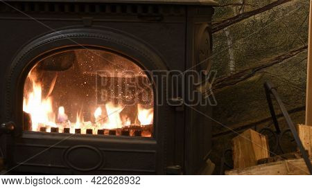 Burning Fire In Cast-iron Potbelly Stove Of Retro Style Interior. Flame In Antique Fireplace. Norweg