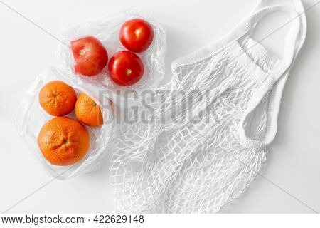 White Mesh Bag, Vegetables, Fruits Flat Lay On White Background Top View. Eco Friendly, Reusable Sho