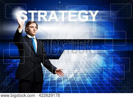 Handsome Businessman In Suit Using Virtual Interface Of Computer Application. Innovation Technology
