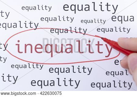 A Hand With A Pink Marker Is Circling The Word Inequality.