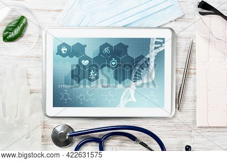 Human Genetic Research In Modern Medical Laboratory. Tablet Computer With Dna Helix Structure On Scr