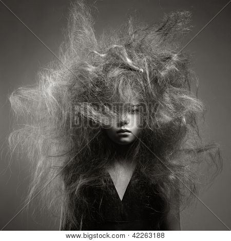 Black and white portrait of a young girl with a volume fashionable hairstyle poster