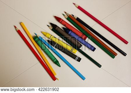 Colored Pencils On A White Background. Lots Of Different Colored Wax Pencils. Colored Pencil. Drawin