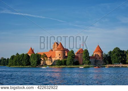 Trakai Island Castle in lake Galve with boats and yachts in summer day with beautiful sky, Lithuania. Trakai Castle is one of major tourist attractions of Lituania