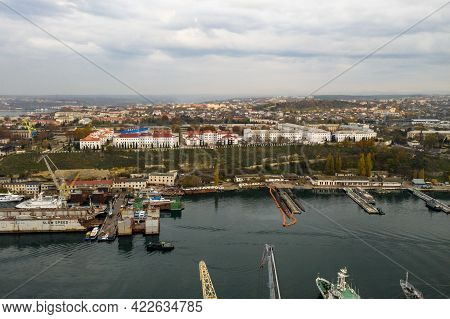 Bay With Ships In The City. South Bay In Sevastopol With Civilian And Military Ships. Sevastopol Uni