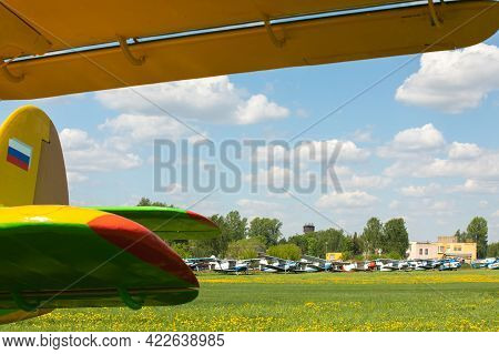 May 22, 2021, Russia, Moscow. Biplane An-2 In The Parking Lot At The Airfield On The Green Lawn. Row