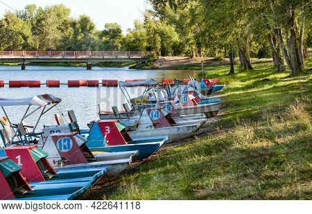 Catamarans On The Bank Of The River On Summer Bright Day.