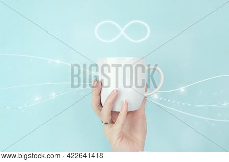 The Infinity Way To Nowhere, Business Confusion Concept. Cropped View Of Female Hand With White Coff