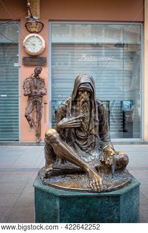 North Macedonia, Skopje, May 2021 Beggar Sculpture In The Capital Of Macedonia