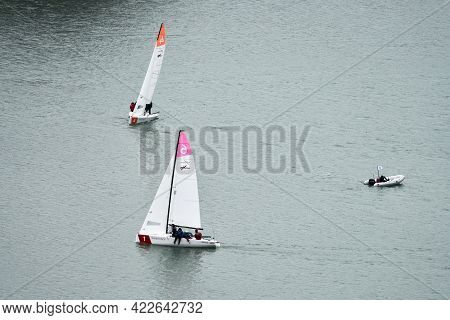 Russia, Abrau Durso, April 10, 2021: Preparation For The Sailing Regatta. Lake With Two Sports Keel