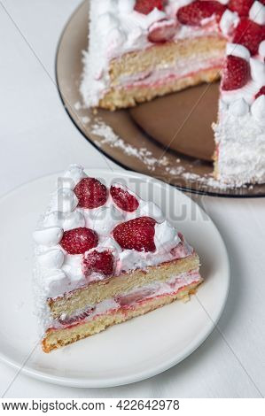 Creamy Strawberry Cake. Homemade Cake With Whipped Cream And Fresh Strawberries. Cut Piece Of Cake